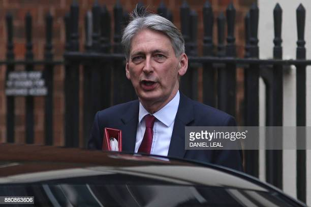 Britain's Chancellor of the Exchequer Philip Hammond reacts as he leaves 11 Downing Street in central London on November 28 2017 / AFP PHOTO / Daniel...