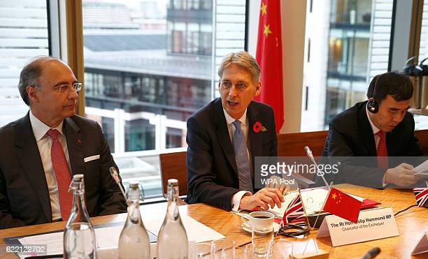 Britain's Chancellor of the Exchequer Philip Hammond speaks at a roundtable meeting with CEO of the London Stock Exchange Xavier Rolet and Tian Guoli...
