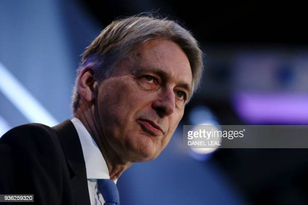 Britain's Chancellor of the Exchequer Philip Hammond speaks during the The International FinTech Conference 2018 in central London on March 22 2018 /...
