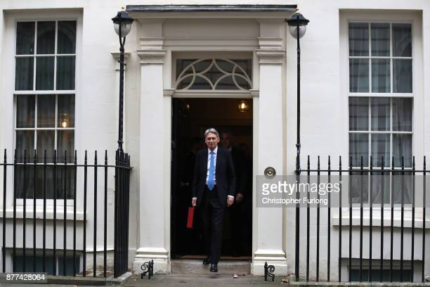 Britain's Chancellor of the Exchequer Philip Hammond walk out holding the red case as he departs 11 Downing Street to deliver his budget to...