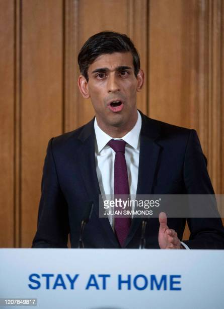 Britain's Chancellor of the Exchequer Rishi Sunak addresses a news conference to give a daily update on the government's response to the novel...