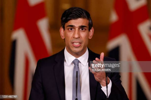 Britain's Chancellor of the Exchequer Rishi Sunak attends a virtual press conference inside 10 Downing Street in central London on March 3 following...