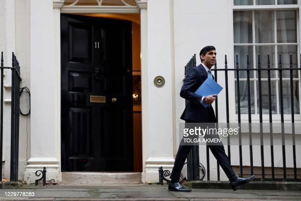 Britain's Chancellor of the Exchequer Rishi Sunak leaves 11 Downing Street in central London, on November 25 before heading to the House of Commons...