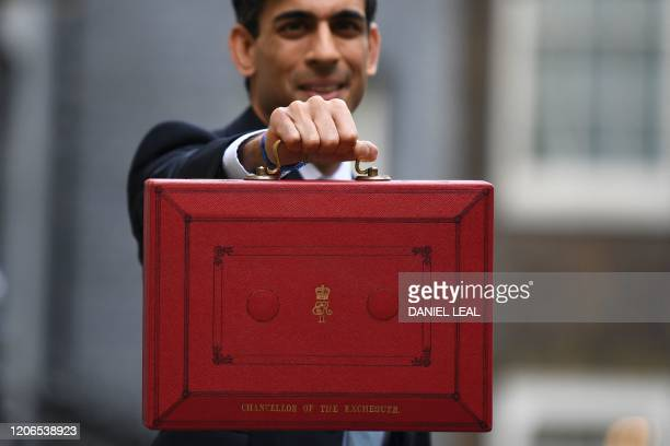 Britain's Chancellor of the Exchequer Rishi Sunak poses for pictures with the Budget Box as he leaves 11 Downing Street on March 11, 2020 ahead of...