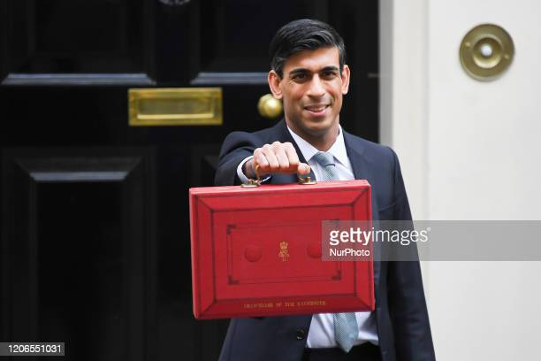 Britain's Chancellor of the Exchequer Rishi Sunak stands outside 11 Downing Streetas he poses for pictures with the Budget Box on March 11 2020 ahead...