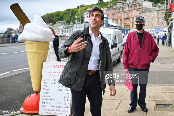 Britain's Chancellor of the Exchequer Rishi Sunak visits local businesses in Rothesay on the Isle of Bute, Scotland on August 07, 2020.