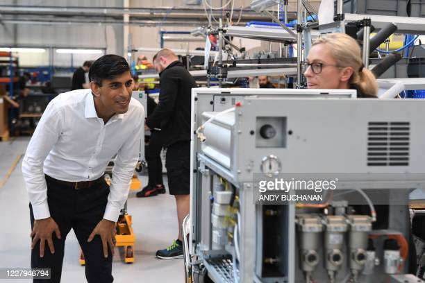 Britain's Chancellor of the Exchequer Rishi Sunak visits Peak Scientific a Scottish manufacturer of gas generators for analytical laboratories in...