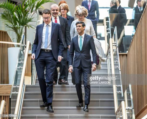 Britain's Chancellor of the Exchequer Rishi Sunak with Simon Clarke MP gestures on his arrival to the Nexus Building at the University of Leeds...