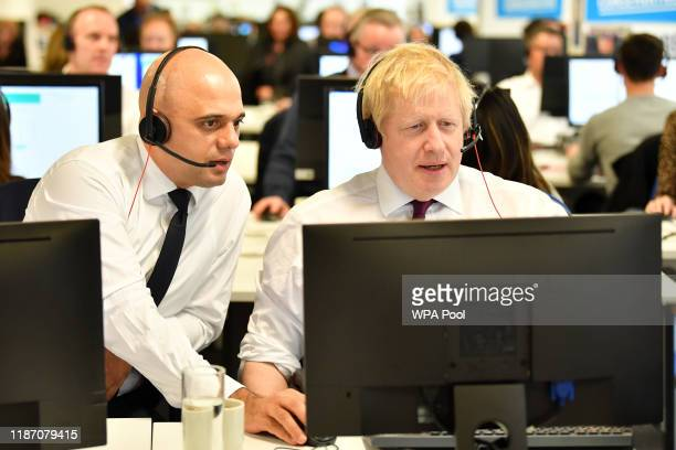 Britain's Chancellor of the Exchequer Sajid Javid and Britain's Prime Minister Boris Johnson man the phones at the Conservative Campaign Headquarters...