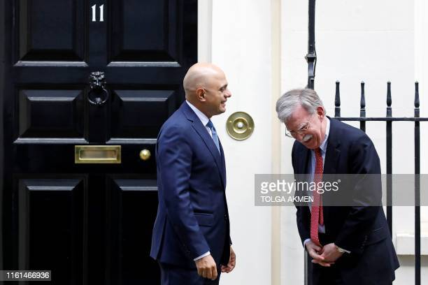 Britain's Chancellor of the Exchequer Sajid Javid greets US National Security Advisor John Bolton outside 11 Downing Street in London on August 13...