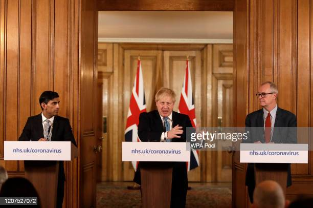 Britain's Chancellor Rishi Sunak, British Prime Minister Boris Johnson and Chief scientific officer Patrick Vallance give a press conference about...