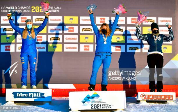Britain's Charlotte Bankes celebrates on the podium after winning the women's big final next to second placed Italy's Michela Moioli and third placed...