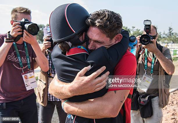 Britain's Charlotte Dujardin embraces her fiance Dean Golding after the Equestrian's Dressage Grand Prix Freestyle event of the Rio 2016 Olympic...