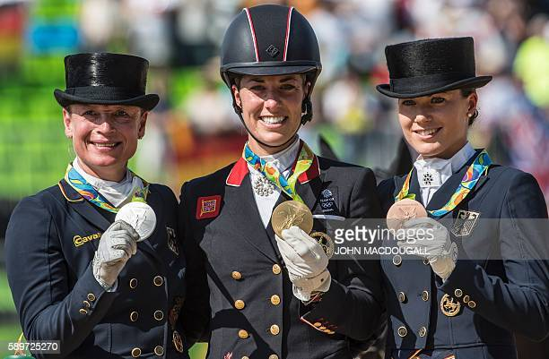 Britain's Charlotte Dujardin , Germany's Isabell Werth and Germany's Kristina Broring-Sprehe show their gold, silver and bronze medals respectively...
