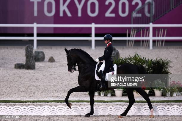 Britain's Charlotte Fry rides Everdale in the dressage individual grand prix group A during the equestrian competition of the Tokyo 2020 Olympic...