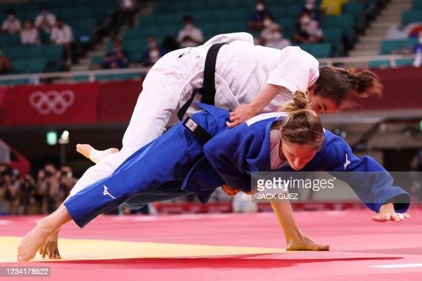 Britain's Chelsie Giles competes with Switzerland's Fabienne Kocher during their judo women's -52kg bronze medal B bout during the Tokyo 2020 Olympic...