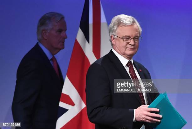 Britain's chief Brexit negotiator David Davis and EU's chief Brexit negotiator Michel Barnier arrive to address the media after a sixth round of...