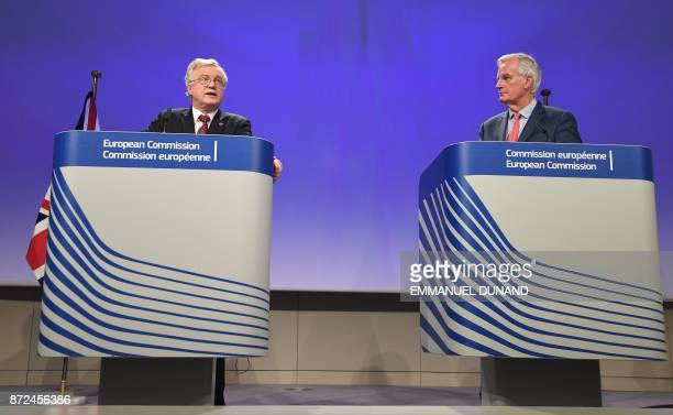 Britain's chief Brexit negotiator David Davis and EU's chief Brexit negotiator Michel Barnier address the media after a sixth round of Brexit talks...
