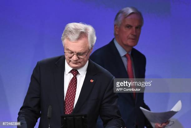 Britain's chief Brexit negotiator David Davis and EU's chief Brexit negotiator Michel Barnier arrive to address the media following a sixth round of...