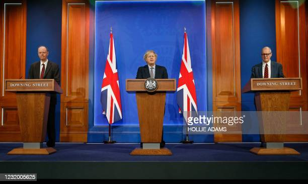 Britain's Chief Medical Officer for England Chris Whitty , Britain's Prime Minister Boris Johnson and Britain's Chief Scientific Adviser Patrick...