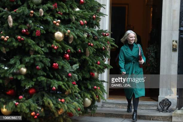 Britain's Chief Secretary to the Treasury Liz Truss leaves after attending the weekly meeting of the cabinet at 10 Downing Street in London on...