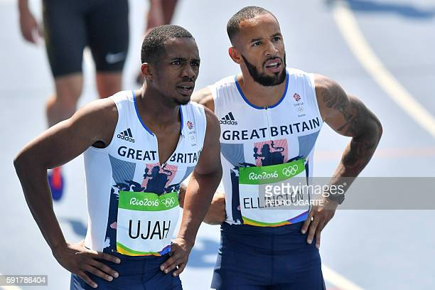 Britain's Chijindu Ujah and Britain's James Ellington look on after competing in the Men's 4 x 100m Relay Round 1 during the athletics event at the...