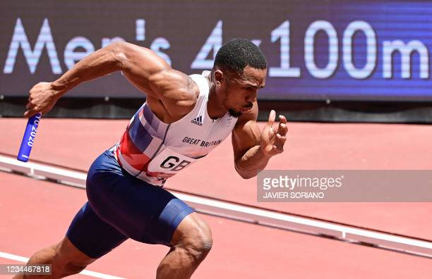 Britain's Chijindu Ujah competes in the men's 4x100m relay heats during the Tokyo 2020 Olympic Games at the Olympic Stadium in Tokyo on August 5,...