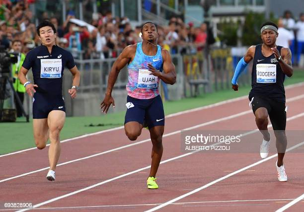 Britain's Chijindu Ujah , flanked by Japans' Yoshihide Kiryu and US Mike Rodgers , runs to win the men's 100m sprint race during the Rome's Diamond...