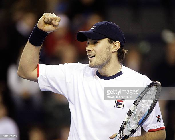 Britain's Chris Eaton celebrates his 634676 win against Ukraine's Illya Marchenko in the Europe/Africa zone Group I second round Davis Cup match at...