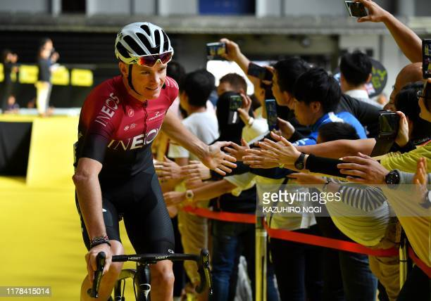 TOPSHOT Britain's Chris Froome of Team Ineos greets fans after the opening ceremony of the 2019 Tour de France Saitama criterium cycling race in...