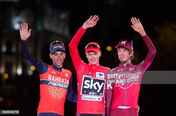 Britain's Chris Froome of Team Sky celebrates on the podium with second placed Italy's Vincenzo Nibali of the Bahrain-Merida's team and third placed...