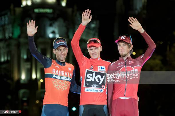 Britain's Chris Froome of Team Sky celebrates on the podium with second placed Italy's Vincenzo Nibali of the BahrainMerida's team and third placed...