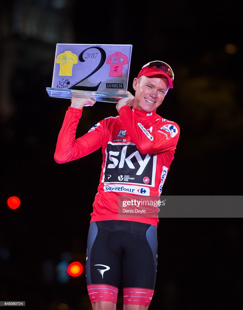 Britain's Chris Froome of Team Sky celebrates with his trophy for winning the Tour de France and Vuelta a Espana in the same year on the podium after winning the Vuelta a Espana race after the Stage 21 on September 10, 2017 in Madrid, Spain.