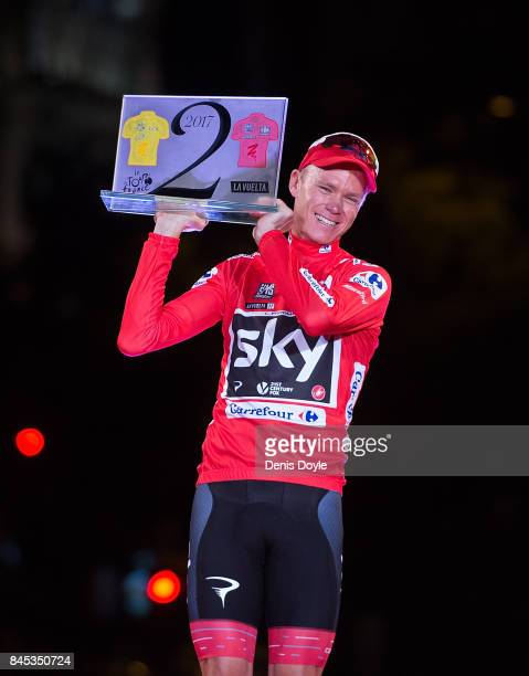 Britain's Chris Froome of Team Sky celebrates with his trophy for winning the Tour de France and Vuelta a Espana in the same year on the podium after...