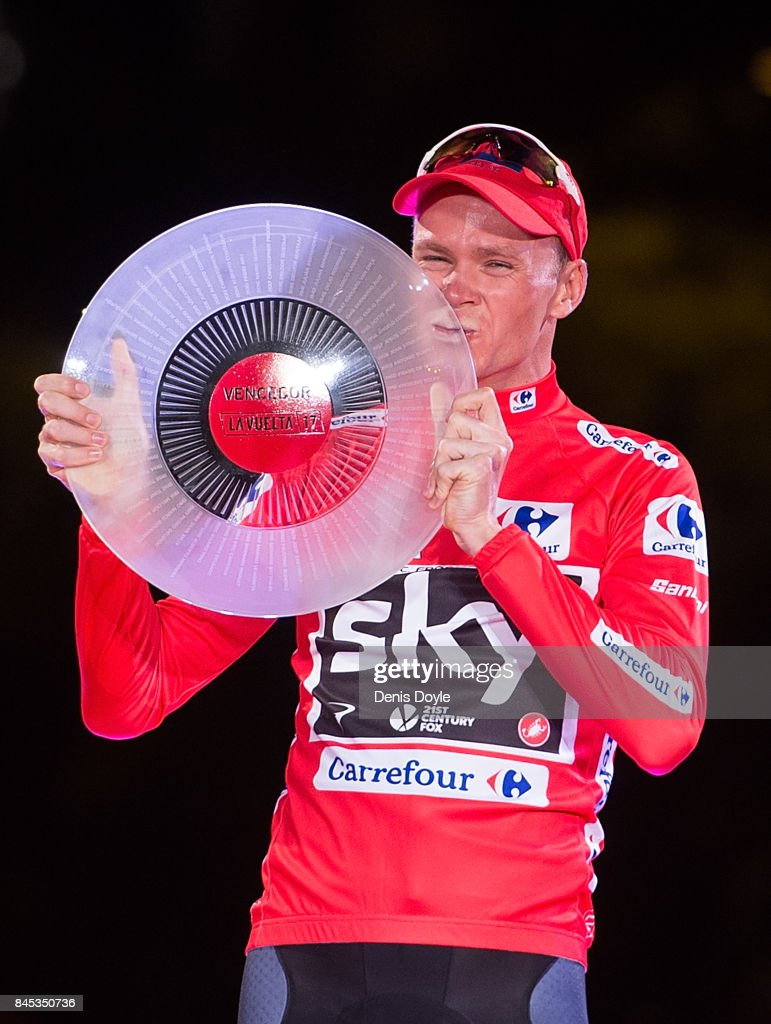 Britain's Chris Froome of Team Sky celebrates with his trophy on the podium after winning the Vuelta a Espana cycling race after the Stage 21 on September 10, 2017 in Madrid, Spain.