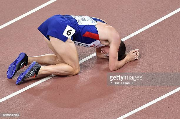 Britain's Chris O'Hare reacts at the end of his semifinal of the men's 1500 metres athletics event at the 2015 IAAF World Championships at the Bird's...