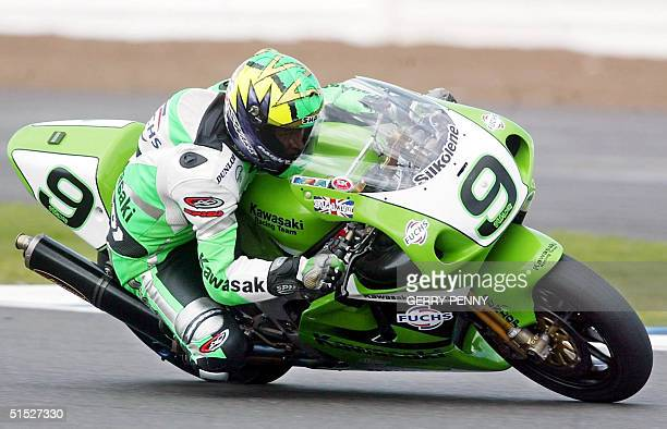 Britain's Chris Walker on Kawasaki ZX7RR rounds Copse Corner in practice 25 May 2002 for Sunday's World Super Bike Championship at Silverstone race...