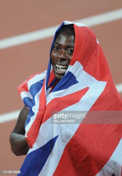 Britain's Christine Ohuruogu, wrapped in her national flag, celebrates winning the women's 400m final at the National Stadium during the 2008 Beijing...