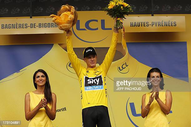 Britain's Christopher Froome celebrates his yellow jersey of overall leader on the podium at the end of the 168.5 km ninth stage of the 100th edition...