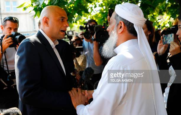 Britain's Communities and Local Government Secretary Sajid Javid speaks to a locals in the Finsbury Park area of north London after a vehicle was...