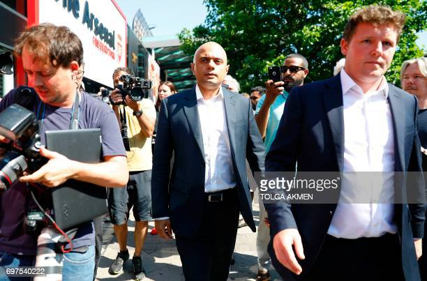Britain's Communities and Local Government Secretary Sajid Javid arrives to meet locals in the Finsbury Park area of north London after a vehicle was...