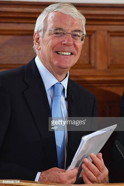 Britain's Conservative former prime minister John Major smiles as he and Labour former prime minister Tony Blair speak at the University of Ulster in...