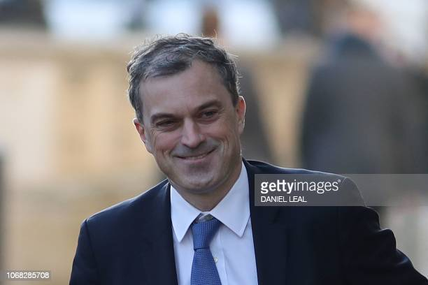 Britain's Conservative Party Chief Whip Julian Smith arrives to attend the weekly meeting of the cabinet at 10 Downing Street in London on December 4...