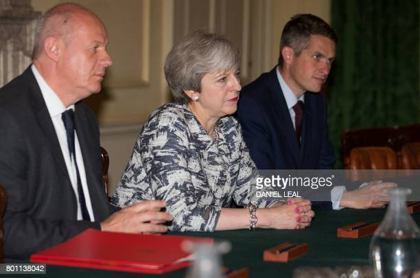 Britain's Conservative party leader and Prime Minister Theresa May sits with Britain's First Secretary of State Damian Green and Britain's...