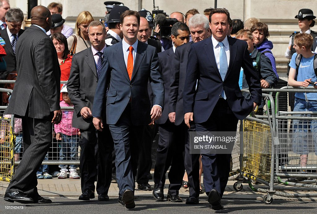 Britain's Conservative Prime Minister, David Cameron (centre R) and Liberal Democrat Deputy Prime Minister, Nick Clegg (centre L) walk to the Houses of Parliament for the State Opening of Parliament, in central London on May 25, 2010. Britain's Queen Elizabeth II set out the new coalition government's legislative programme on Tuesday in a ceremony of pomp and history following the closest general election for decades.