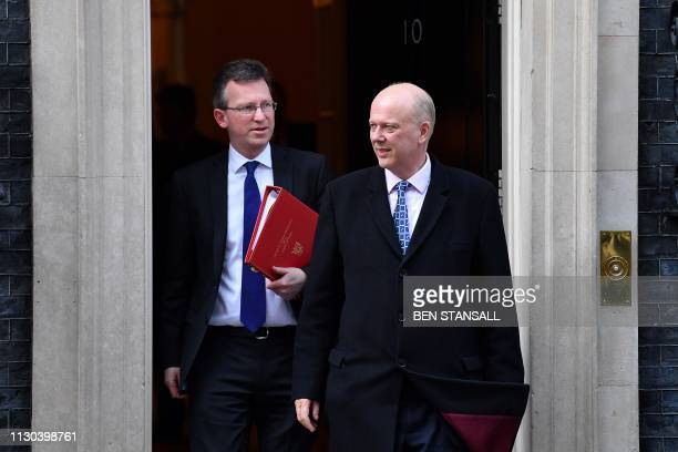 Britain's Culture Secretary Jeremy Wright and Britain's Transport Secretary Chris Grayling leaves after attending a Cabinet meeting at 10 Downing...