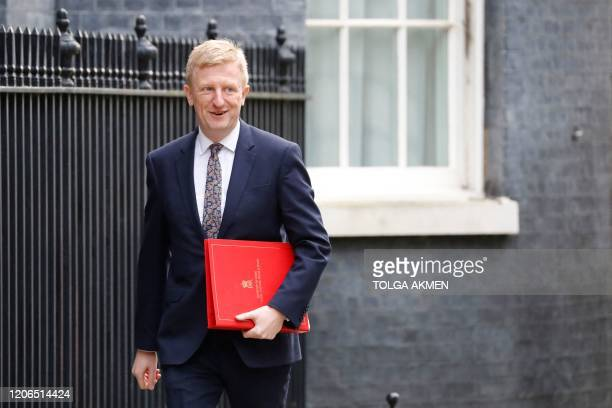 Britain's Culture Secretary Oliver Dowden arrives for a meeting of the cabinet at 10 Downing Street on March 11 2020 ahead of the announcement of...