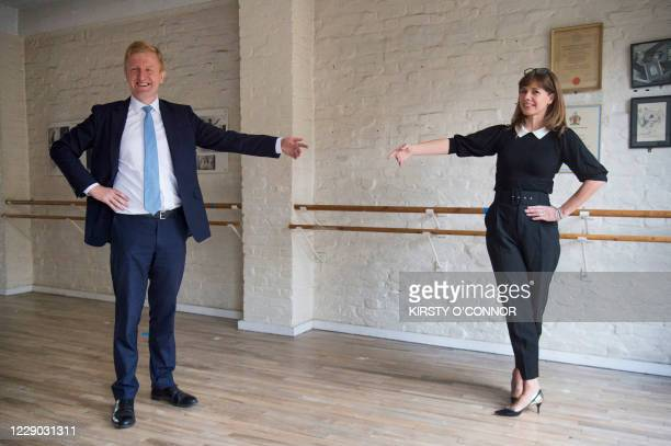 Britain's Culture Secretary Oliver Dowden poses with retired English ballerina Darcey Bussell, during his visit to the Royal Academy of Dance in...