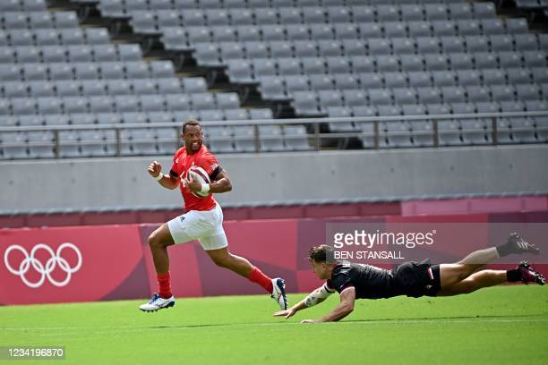 Britain's Dan Norton runs for the try in the men's pool B rugby sevens match between Britain and Canada during the Tokyo 2020 Olympic Games at the...