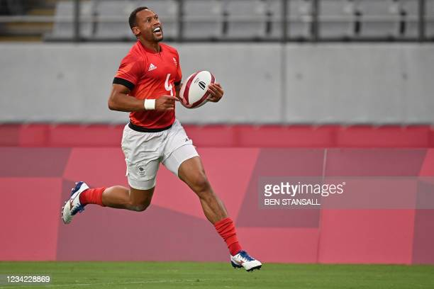 Britain's Dan Norton scores a try in the men's quarter-final rugby sevens match between Britain and the US during the Tokyo 2020 Olympic Games at the...